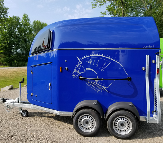 Road Side View of Royal Blue Comfort Trailer
